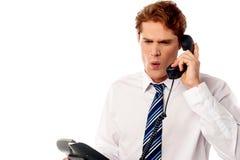 Gridare frustrato dell'uomo d'affari Immagine Stock