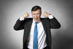 Gridare l'uomo di affari Fotografie Stock