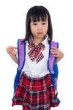 Gridare la piccola ragazza cinese asiatica dello studente con la borsa di scuola Fotografie Stock Libere da Diritti