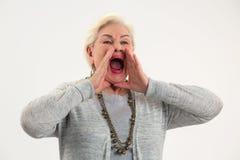 Gridare senior di signora fotografia stock
