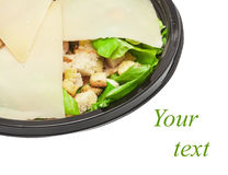 Griddled chicken caesar salad covered with cheese Stock Photo