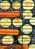 Griddled sliced carrots and zucchini close up. Top view royalty free stock photos