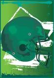 Gridiron Helmet Field. Gridiron Helmet On The Field Royalty Free Stock Photos