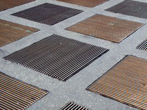 Grids. Urban square with ventilation grids of underground car park Stock Images