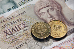 Griechedrachmes, -banknoten und -münzen Stockbild