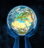 Griechenland auf Planet Erde in den Händen Stockfotos