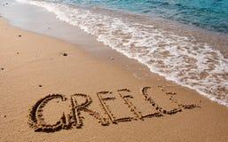 Griechenland - die Beschreibung auf dem Sand Stockfotografie