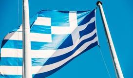 Griechenland-Flagge im fron des Gebäudes des Europäischen Parlaments Stockbilder