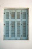 Griechische Fensterblendenverschlüsse Stockfotografie