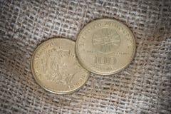 100 griechische Münzen der Drachme mit Alexander der Große Lizenzfreies Stockfoto