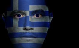 Griechische Markierungsfahne - männliches Gesicht stockbild