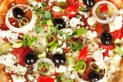 Griechischer Art-Pizza-Hintergrund Stockfoto