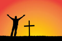 Grief. Silhouette of man and cross at sunset Stock Image