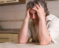 Grief. Senior man in grief at home stock images
