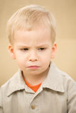 Grief boy. In a corduroy shirt Royalty Free Stock Photo
