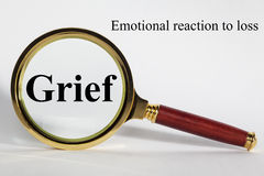 Grief Concept. Looking at Grief through a magnifying glass royalty free stock images