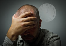 Grief. Man in thoughts. Several minutes past twelve. Man in thoughts and several minutes past twelve. Time concept Stock Photography