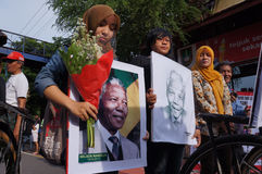 Grief for Mandela. Residents say the sense of condolences on the death of Nelson Mandela in Solo, Central Java, Indonesia Royalty Free Stock Images