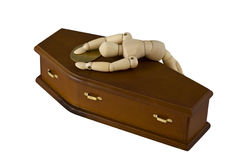 Grief Stricken. Mannequin lying across the closed coffin of a loved one. Isolated on white stock images