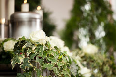 Grief - urn Funeral and cemetery. Religion, death and dolor  - funeral and cemetery; urn funeral Stock Photo