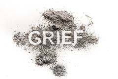 Grief word as sad emotion, mourn for dead loved one. Or heartache for broken love written in dust as sadness, pain or sorrow feeling concept background Royalty Free Stock Photos