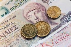 Grieken drachmes, bankbiljetten en muntstukken Stock Foto's