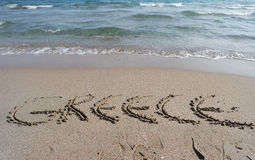 Griekenland bij het strand wordt gebeeldhouwd dat Stock Afbeelding