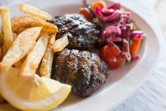 Grieks voedsel, Korfu, Griekenland Stock Afbeeldingen