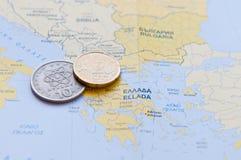 Griekse Drachme en Eurocent op een Griekse Kaart Royalty-vrije Stock Afbeeldingen