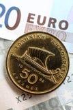Griekse drachme op euroverticaal Royalty-vrije Stock Afbeeldingen