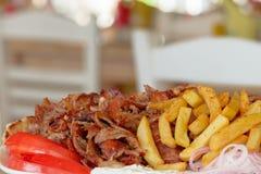 Griekse gyroscopen, souvlaki, vlees stock foto