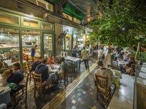 Griekse restaurant en barbuitenkant Stock Foto's