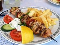 Griekse souvlaki van het maaltijdvarkensvlees stock fotografie