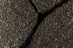 Grieta en el asfalto Fotos de archivo libres de regalías