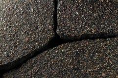 Grieta en el asfalto Imágenes de archivo libres de regalías