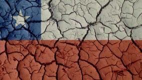 Grietas del fango con la bandera de Chile fotos de archivo libres de regalías