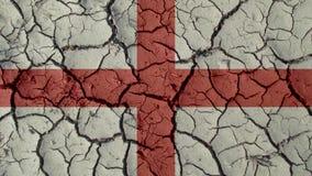 Grietas del fango con la bandera de Inglaterra fotografía de archivo libre de regalías