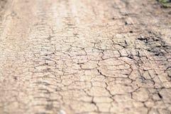 Grietas en tierra seca Fotos de archivo