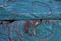Grietas grandes entre dos tableros de la turquesa imagenes de archivo
