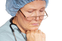 Grieving nurse Royalty Free Stock Photos