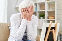 Grieving Senior Woman Crying stock images