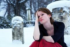 Grieving Teen. Beautiful teen girl grieving in a snow covered cemetary Royalty Free Stock Photos