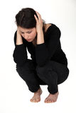Grieving woman. Crouching on the floor Stock Photography