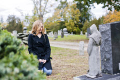 Grieving Woman In Cemetery Royalty Free Stock Images