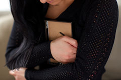 Grieving woman with photo frame at funeral day Stock Images