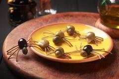 Griezelige crawly eetbare Halloween-spinnen Stock Foto