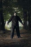 Griezelige gemaskeerde moordenaar Stock Foto