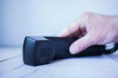 Griff nach Telefon Stock Photos