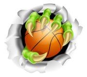 Griffe avec l'éclatement de boule de basket-ball du fond Photos libres de droits