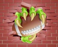 Griffe avec la boule du football traversant le mur de briques illustration de vecteur